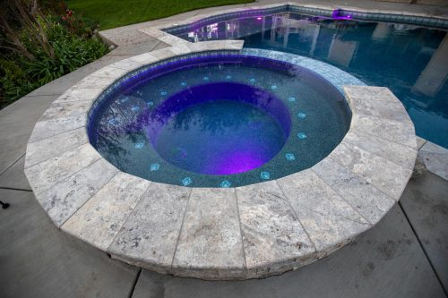 Orange County residential pool spa feature with purple lighting