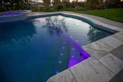 Orange County custom built pool with purple underwater lighting