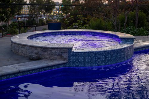 Orange County pool with spa feature and underwater lights built by Pool Icons pool builders