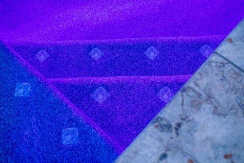 purple underwater lights in residential pool built by Orange County pool builders