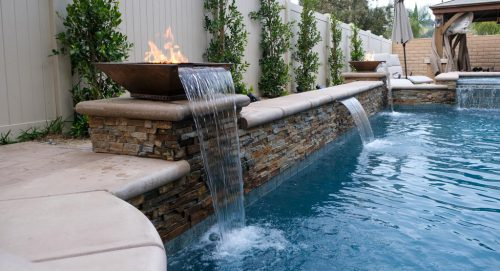 residential pool with poolside fire features and waterfalls