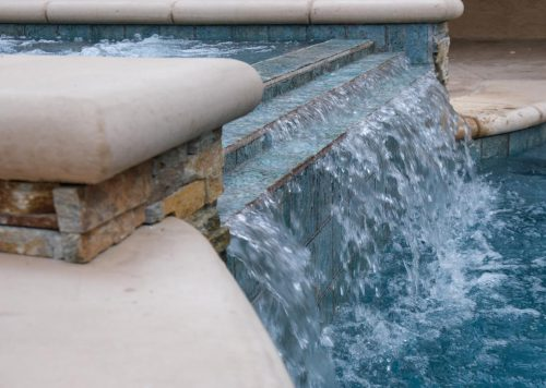 close up of waterfall feature in LA luxury pool built by Los Angeles pool contractors Pool Icons