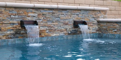 Los Angeles residential pool with custom tiling and waterfall features