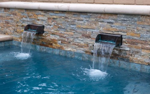 tiling and waterfall features in an LA swimming pool