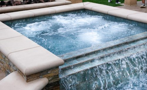 Los Angeles residential pool with waterfall spa feature