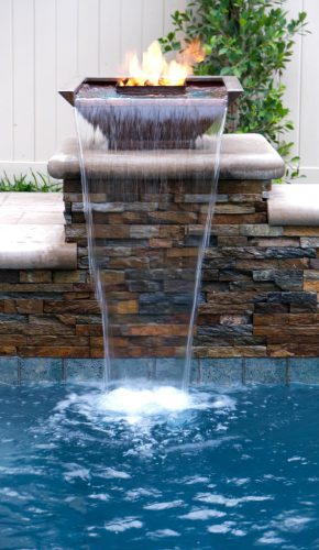 Los Angeles residential pool with waterfall fire features